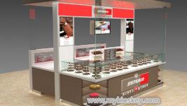 Sleek chocolate bread display kiosk with top decoration
